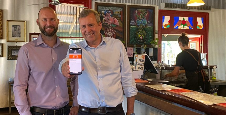 Scantek CEO Ches Rafferty with Liquor Minister Reece Whitby showcase the mobile BDR app